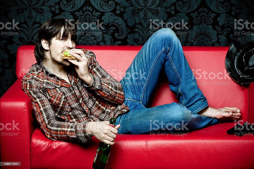 Enjoying fast-food at home royalty-free stock photo