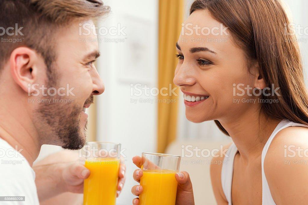 Enjoying fresh juice together. stock photo