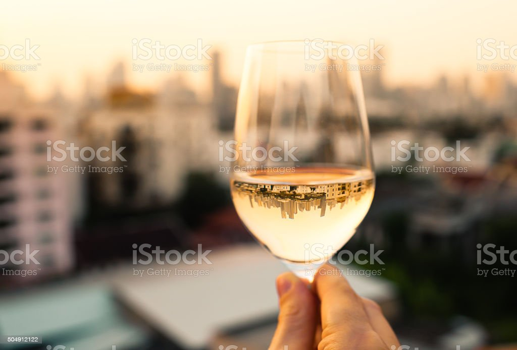 Enjoying glass of wine stock photo