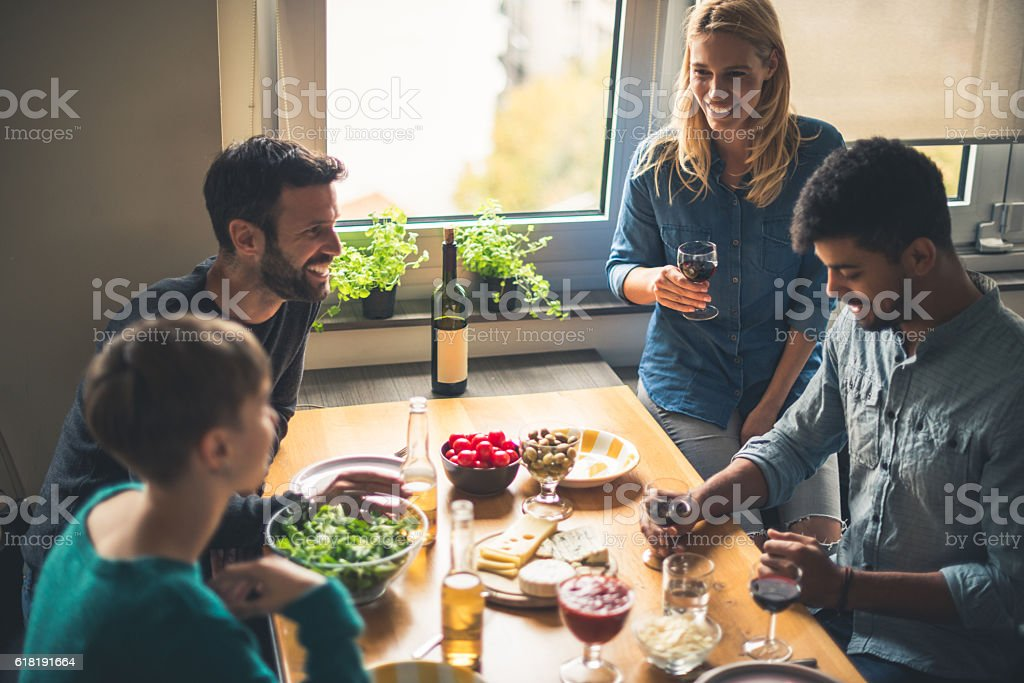 Enjoying good wine and friends stock photo