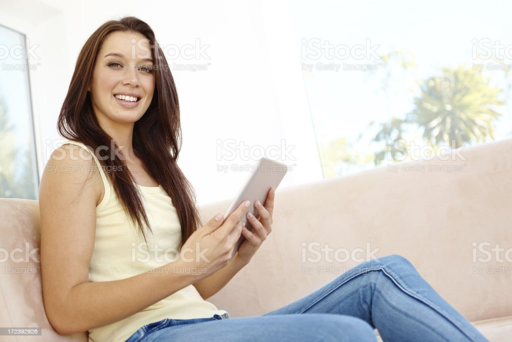 Enjoying her brand new tablet royalty-free stock photo