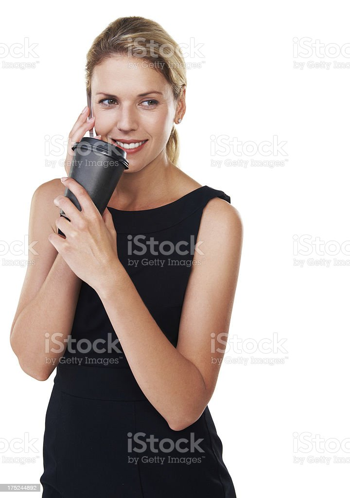 Enjoying her coffee and a phonecall royalty-free stock photo