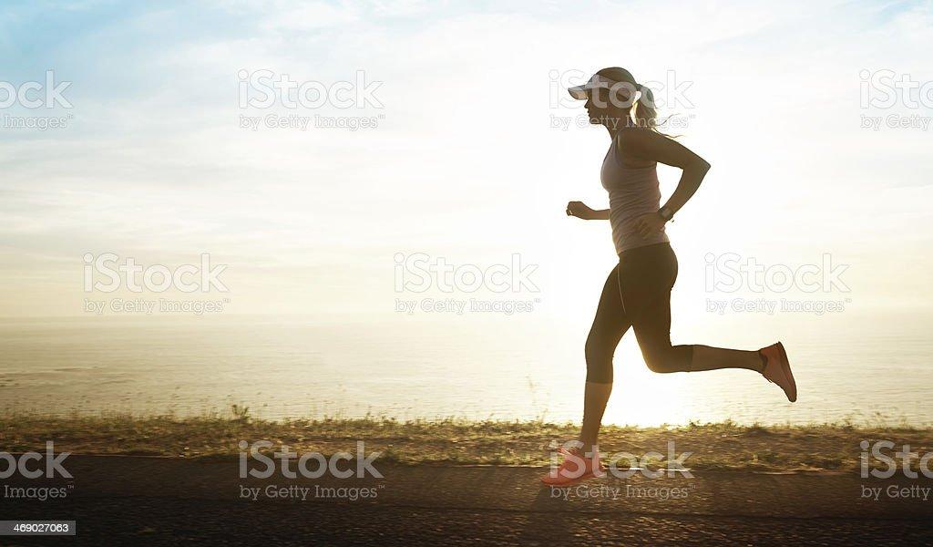 Enjoying her early evening run stock photo
