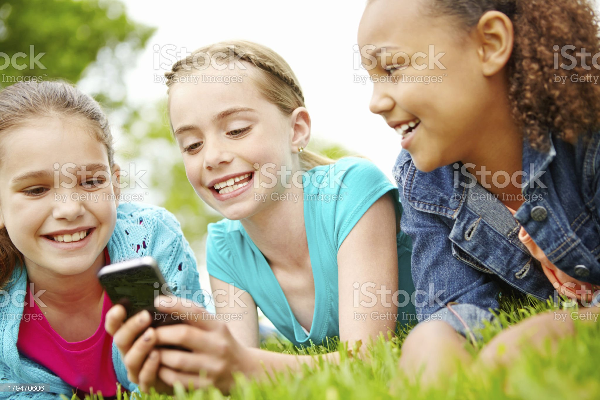 Enjoying her new smartphone royalty-free stock photo