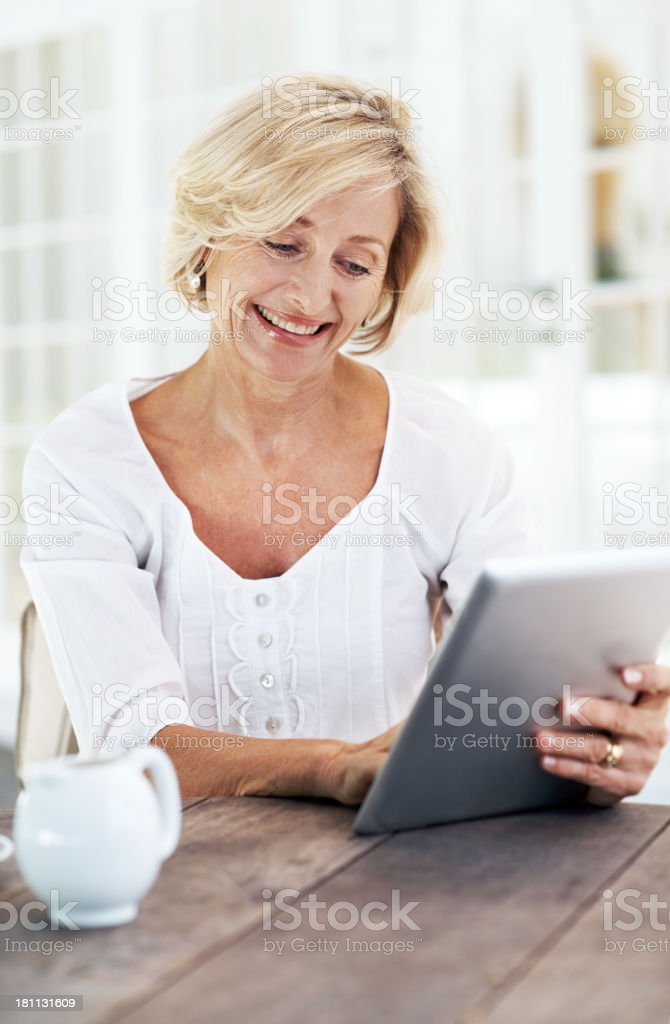 Enjoying her new technological toy! royalty-free stock photo