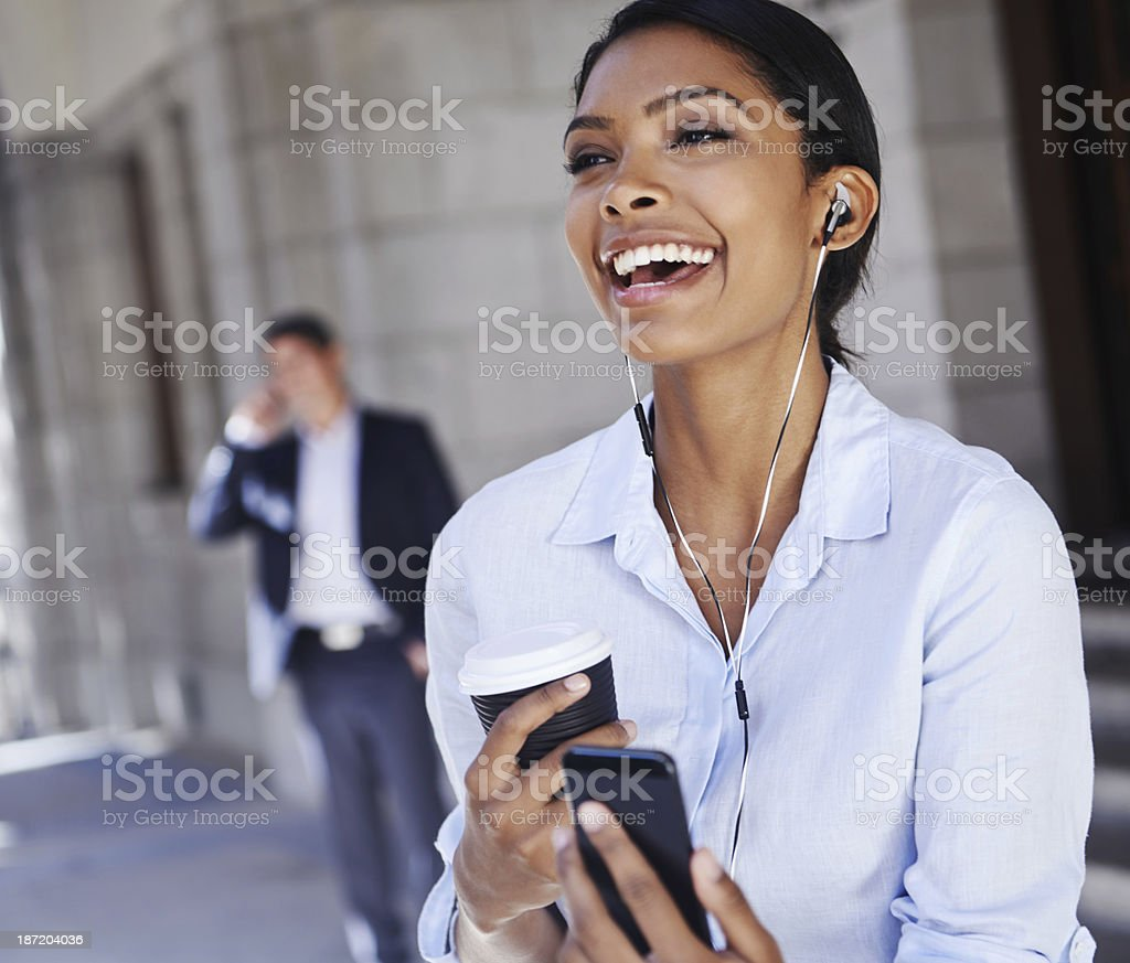Enjoying her tunes on the go royalty-free stock photo