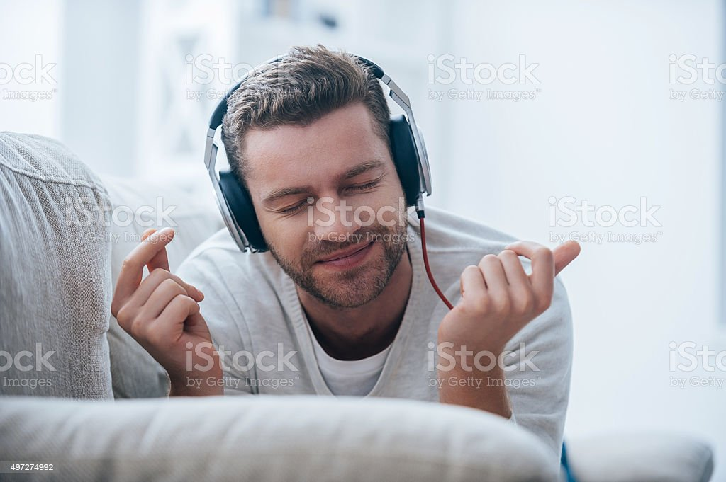 Enjoying his favorite music. stock photo