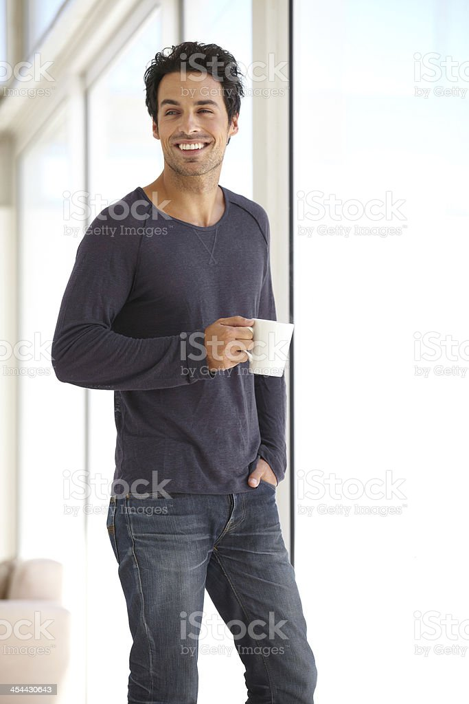 Enjoying his morning cup of coffee royalty-free stock photo