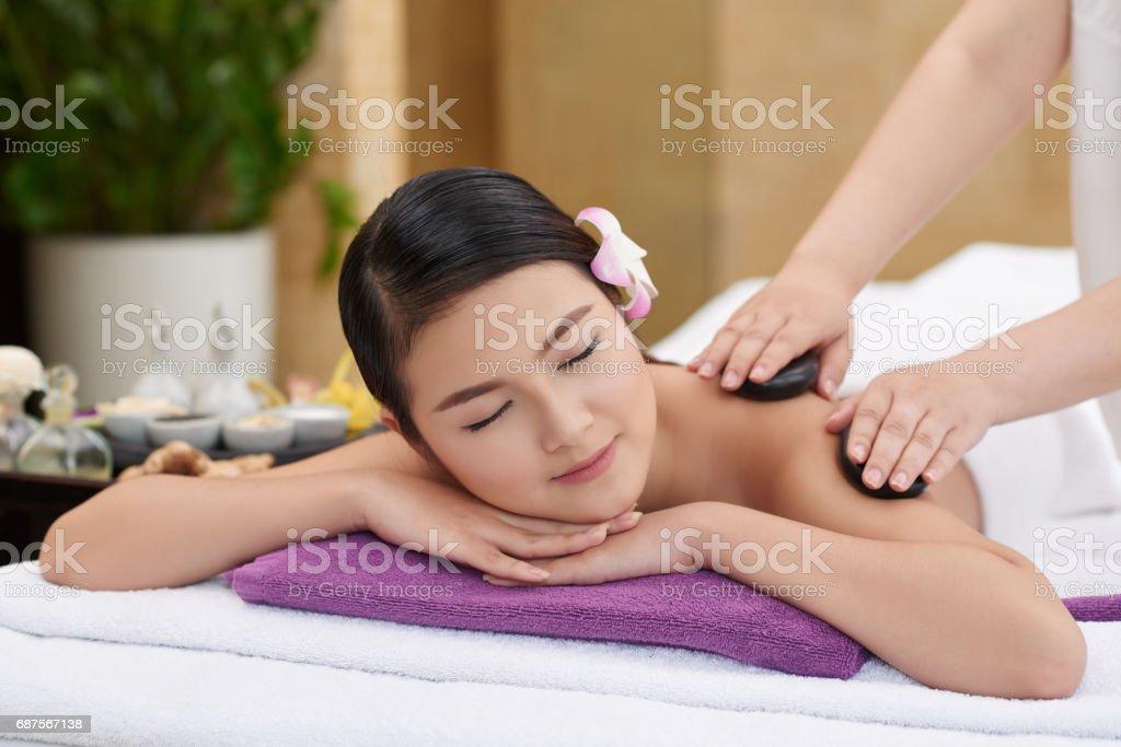 Enjoying Hot Stone Massage stock photo