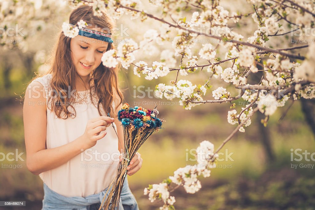 Enjoying in beautiful smell of spring! stock photo