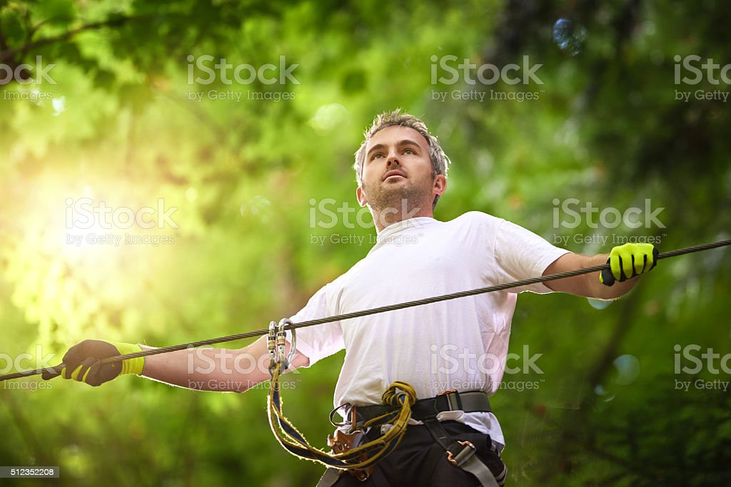 enjoying leisure time in adventure park stock photo