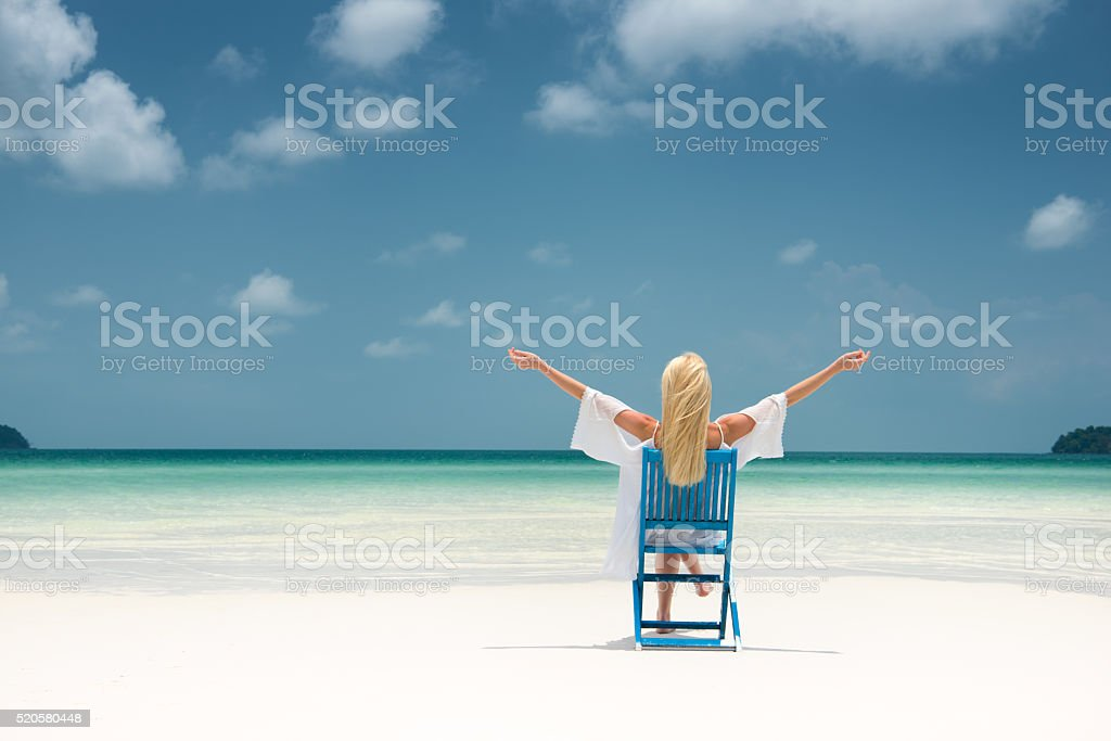Enjoying Life, Perfect Day at the Beach, Arms apart stock photo