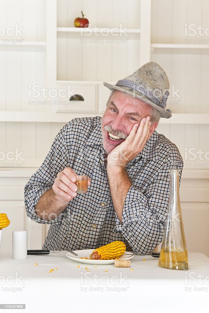Enjoying liquor after hard food stock photo
