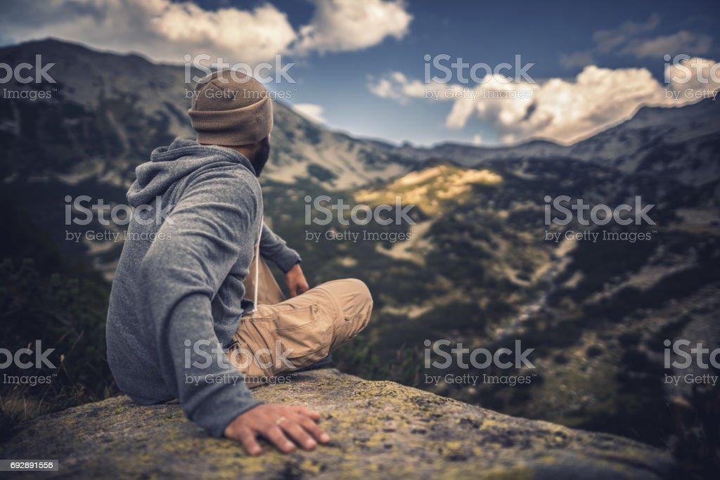 Enjoying majestic mountains and landscape stock photo