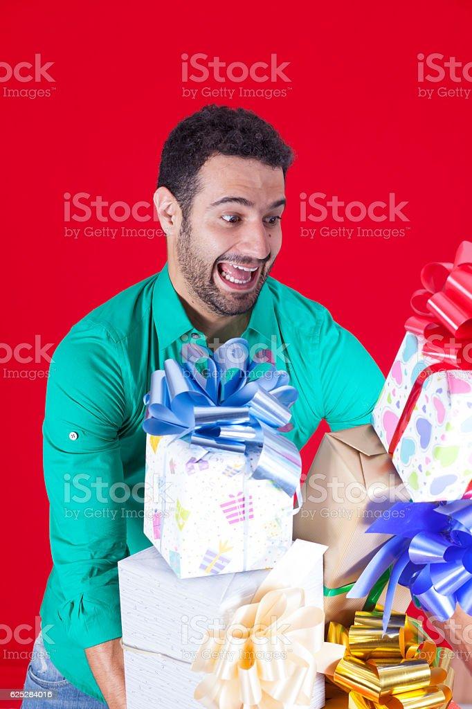 Enjoying many Christmas presents stock photo