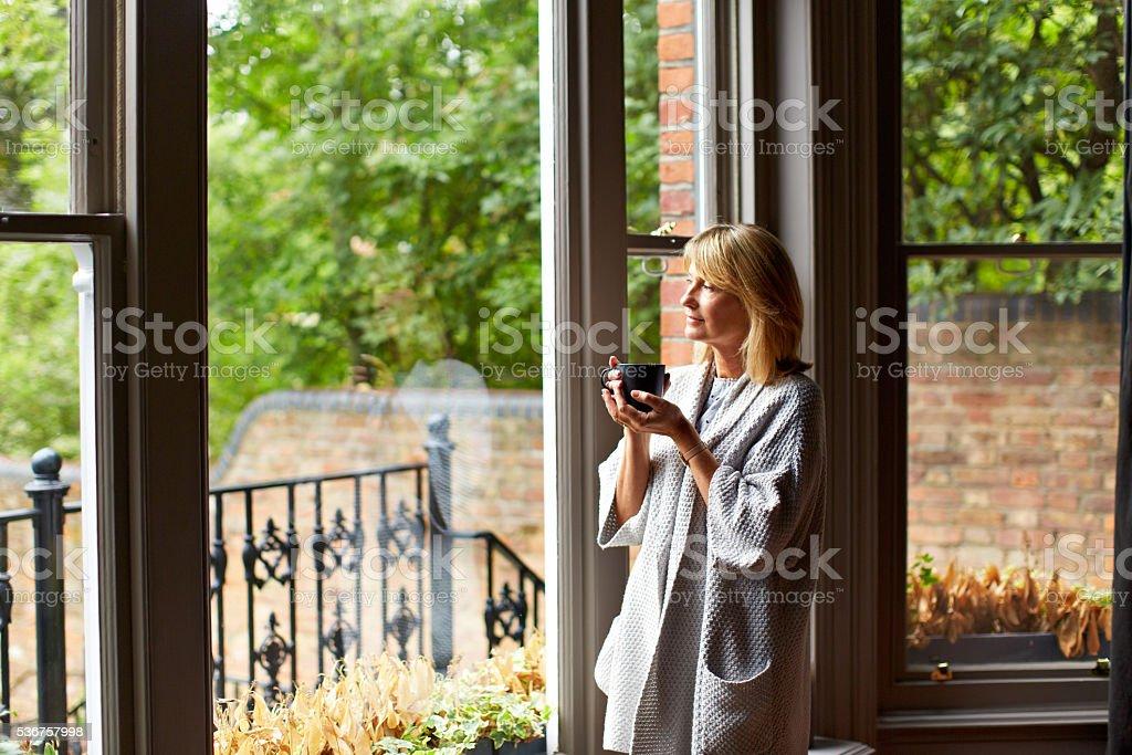 Enjoying morning calm and coffee stock photo