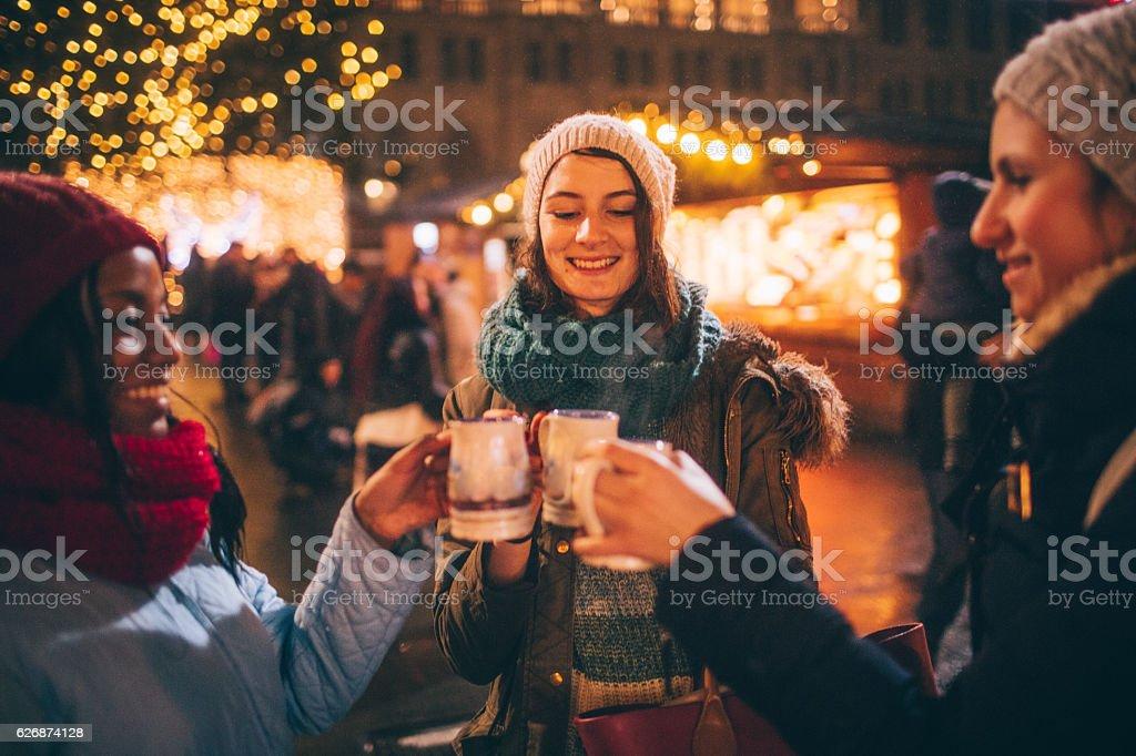 Enjoying mulled wine on Christmas market stock photo