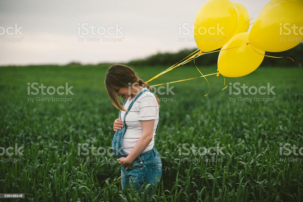 Enjoying my pregnancy stock photo