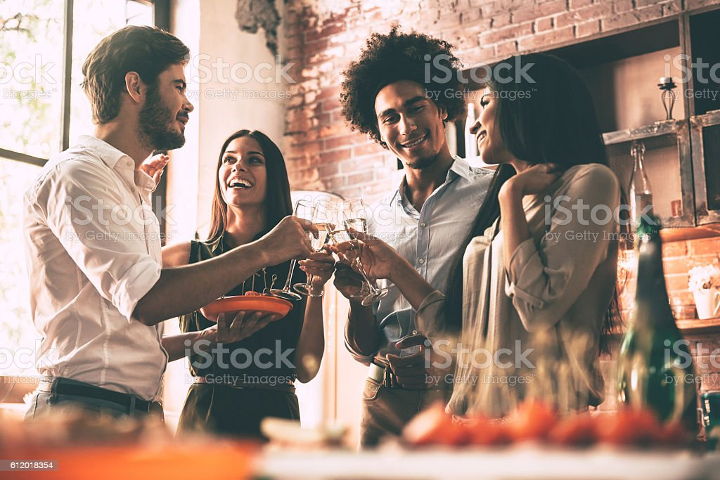 Enjoying party with friends. stock photo