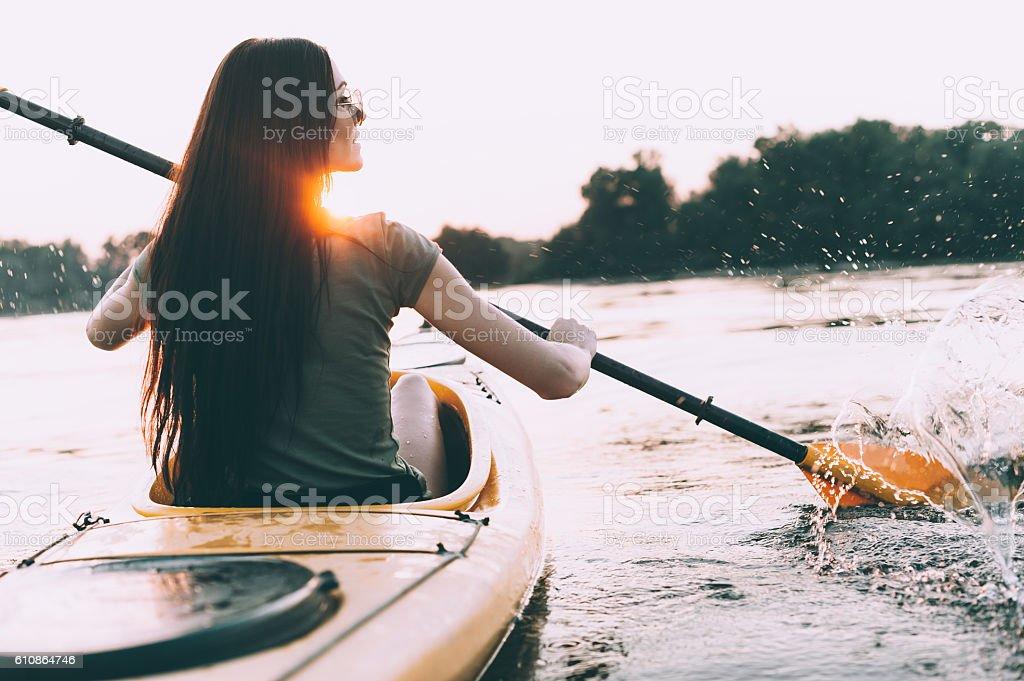 Enjoying perfect sunset on river. stock photo