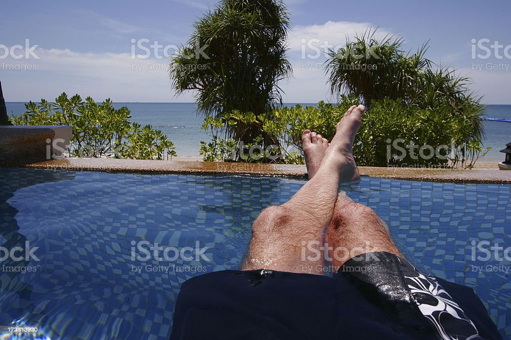 Enjoying private pool in front of the sea royalty-free stock photo