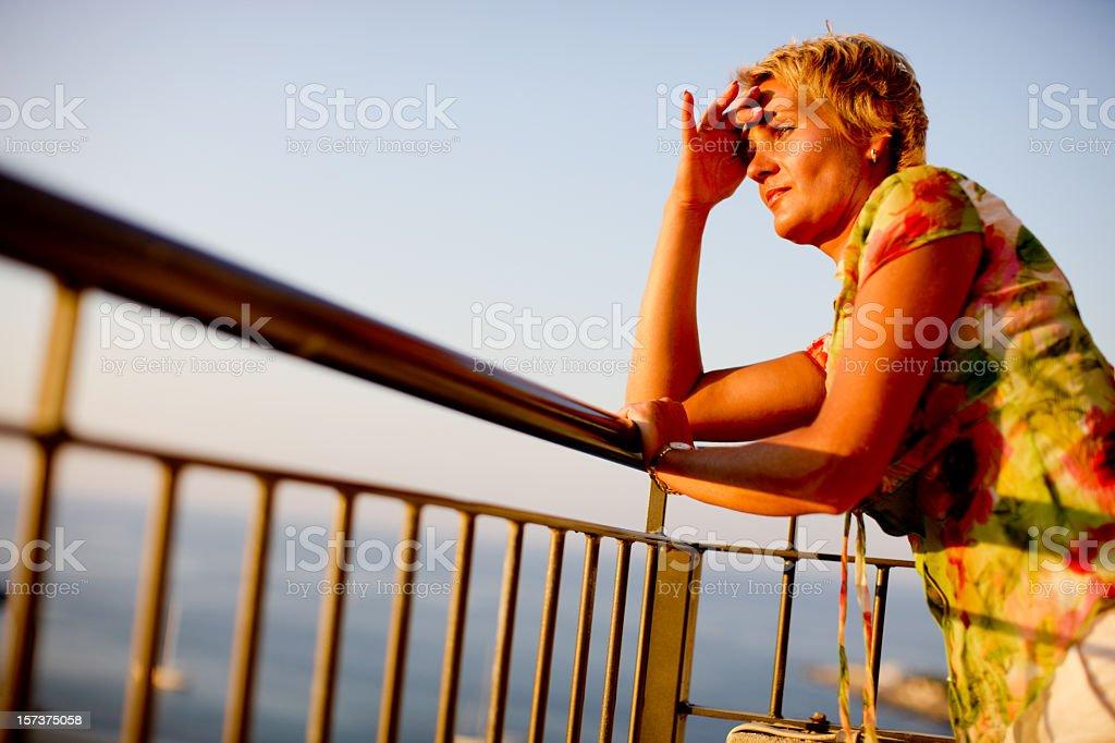Enjoying seascape at sunset royalty-free stock photo