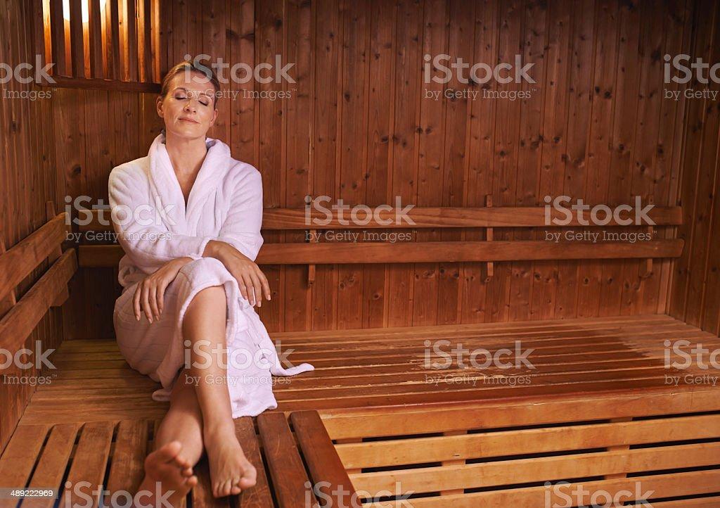 Enjoying some silence in the sauna stock photo