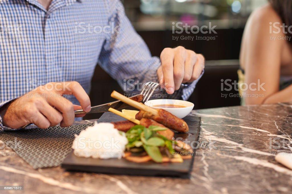 Enjoying tasty dish stock photo