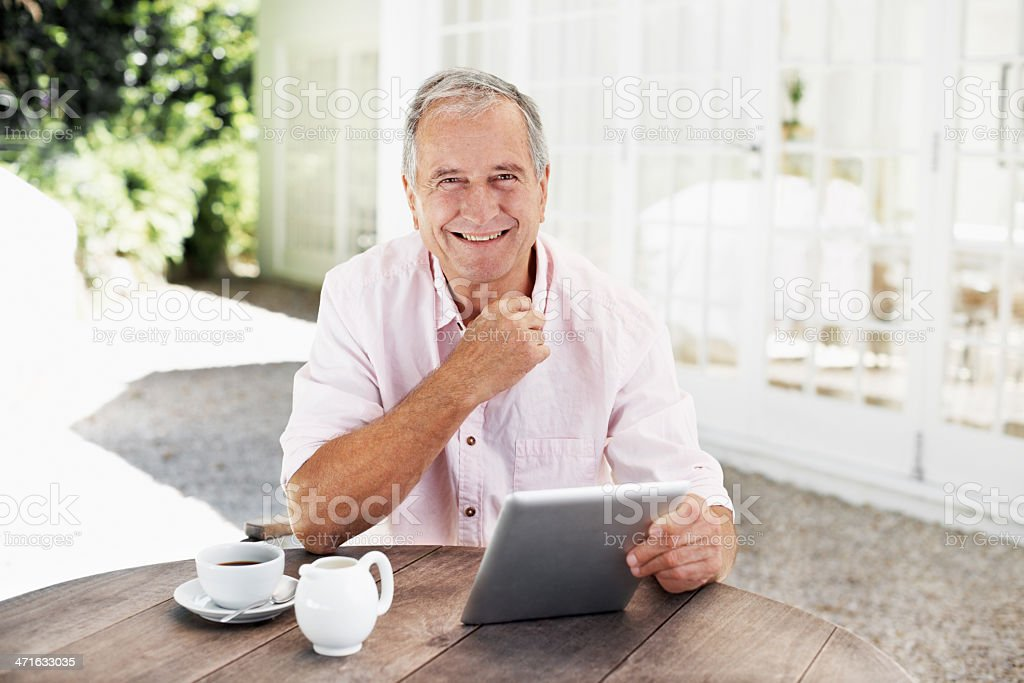 Enjoying the convenience of an e-reader royalty-free stock photo