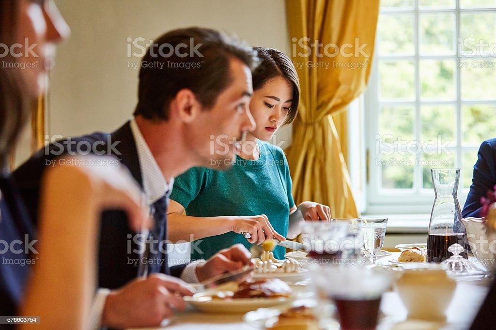 Enjoying the dinner table banter stock photo