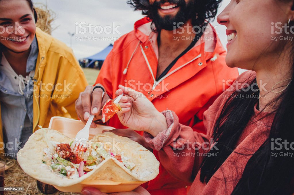 Enjoying the food at a Music Festival stock photo