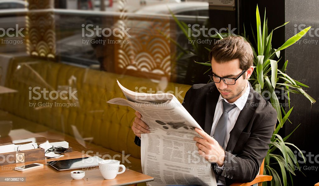 Enjoying the free time for coffee and some news stock photo