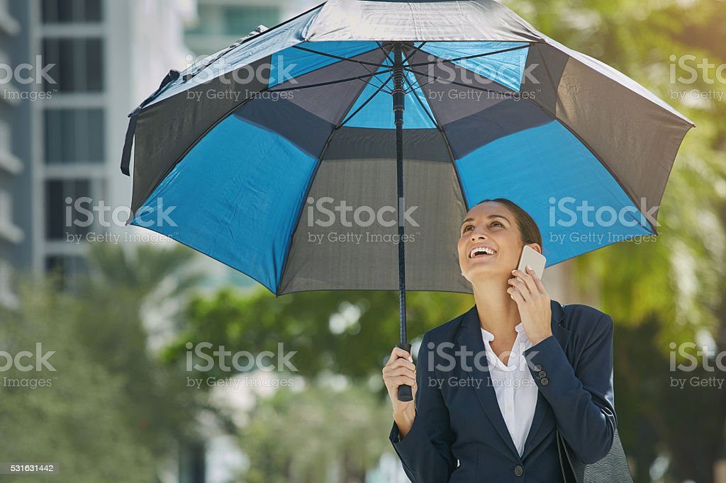 Enjoying the fruits of success knowing that she's fully covered stock photo