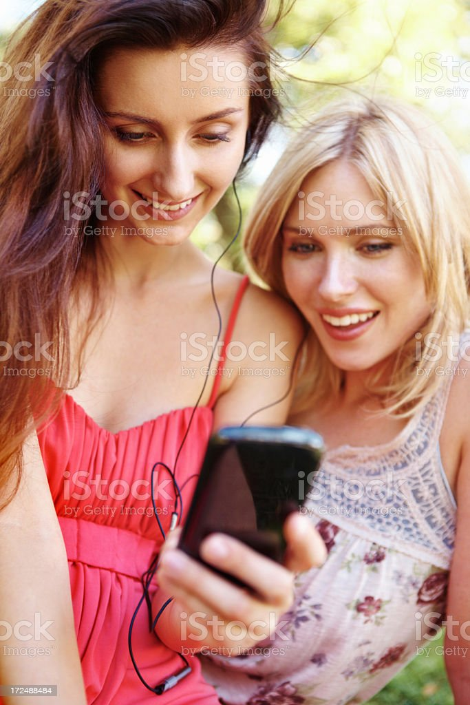 Enjoying the latest cell phone royalty-free stock photo