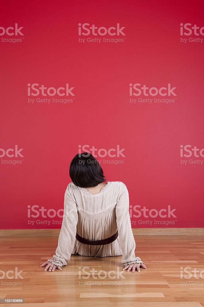 Enjoying the new red wall royalty-free stock photo