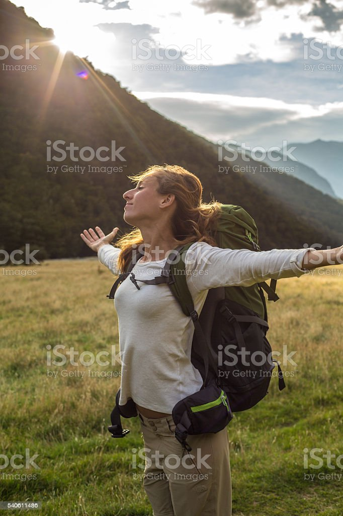 Enjoying the peace and tranquility in mountains at sunrise stock photo