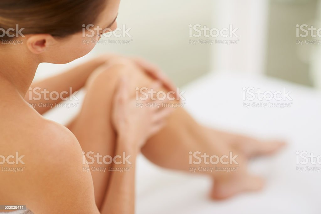 Enjoying the sensation of her skin stock photo