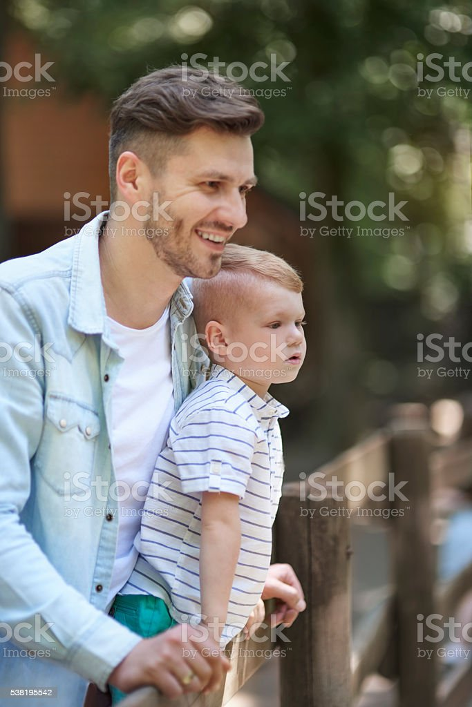 Enjoying the time with daddy at the zoo stock photo
