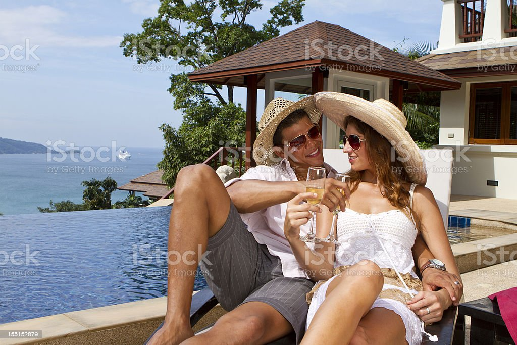 Enjoying the wine and sunshine in a tropical villa royalty-free stock photo