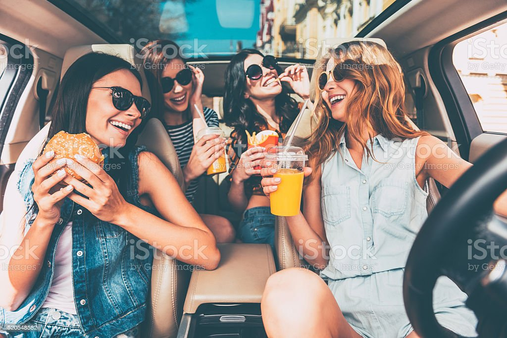 Enjoying their lunch in the car. stock photo