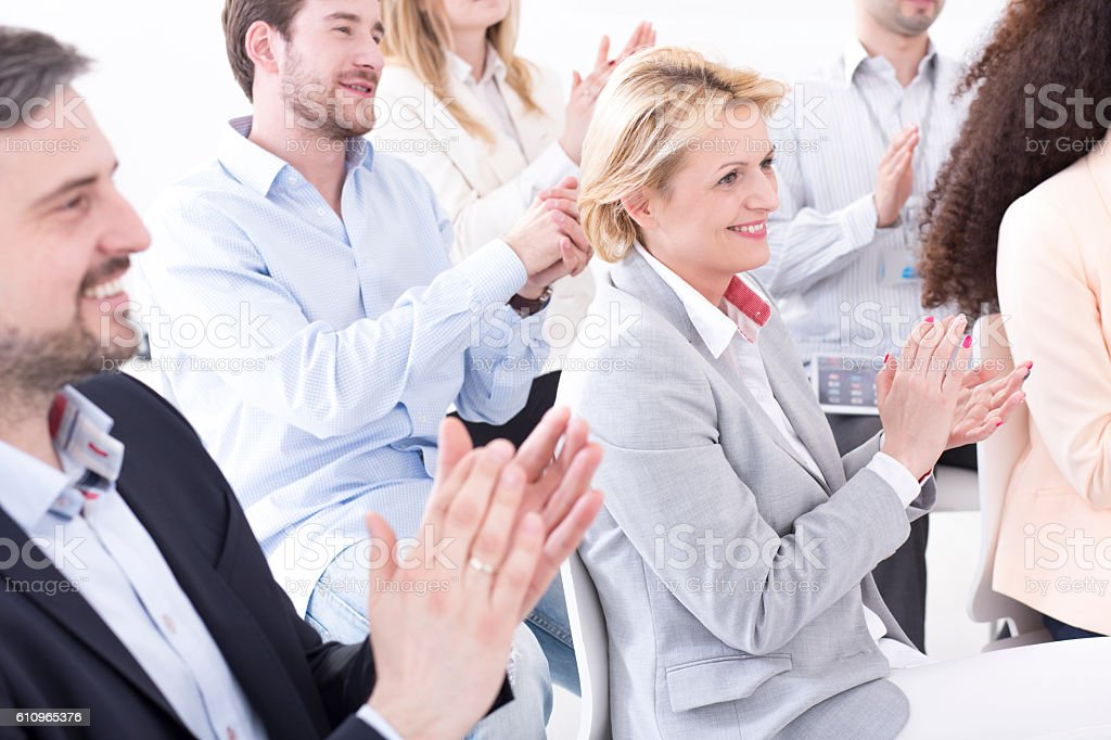 Enjoying their team's successful performance stock photo