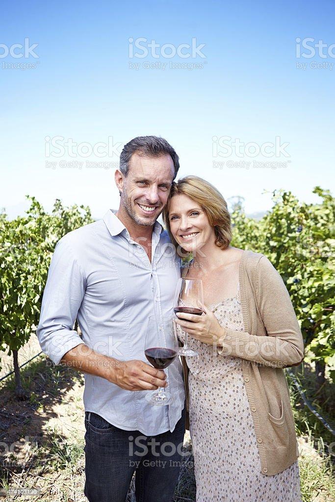 Enjoying their visit to a wine farm royalty-free stock photo