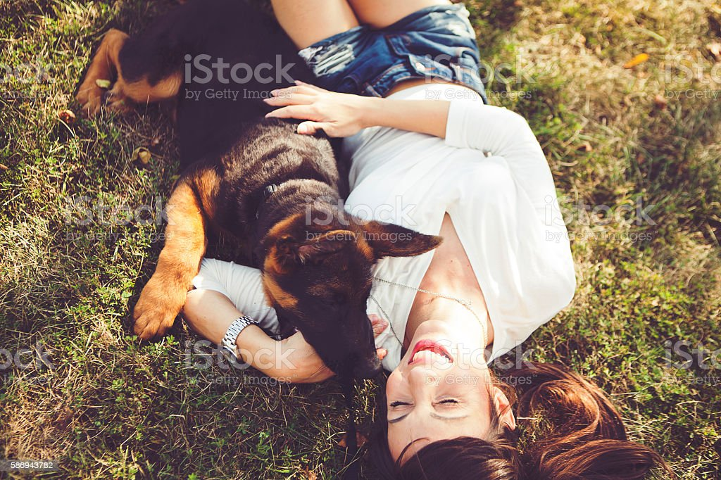 Enjoying time with puppy stock photo