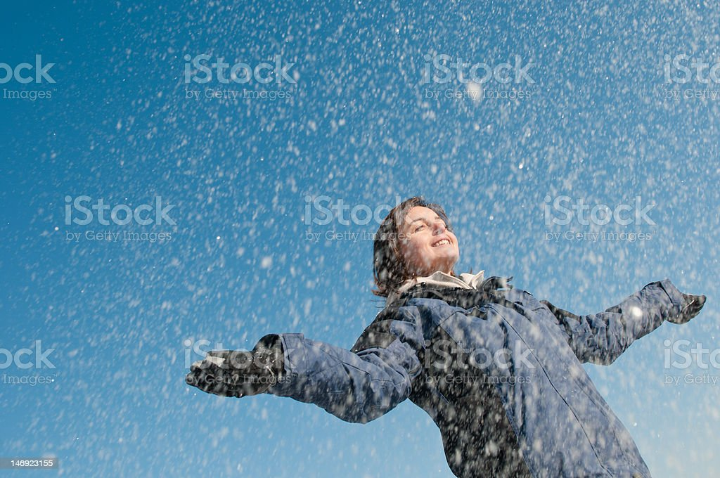 Enjoying winter - woman throwing snow royalty-free stock photo