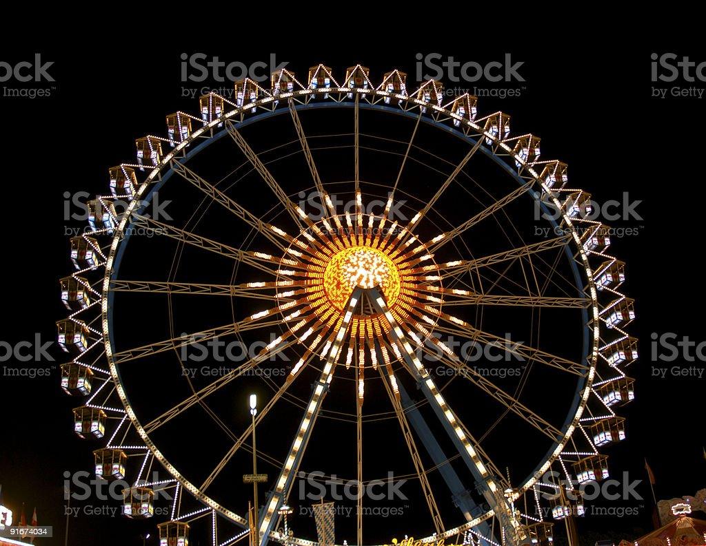 Enlightened giant wheel at the Oktoberfest stock photo