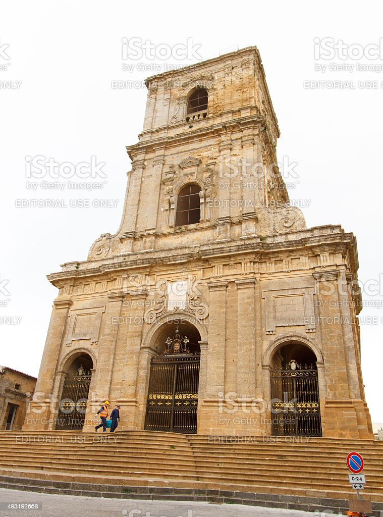 Enna, Sicily: Workmen Hauling Bucket in Front of Cathedral (Duomo) stock photo