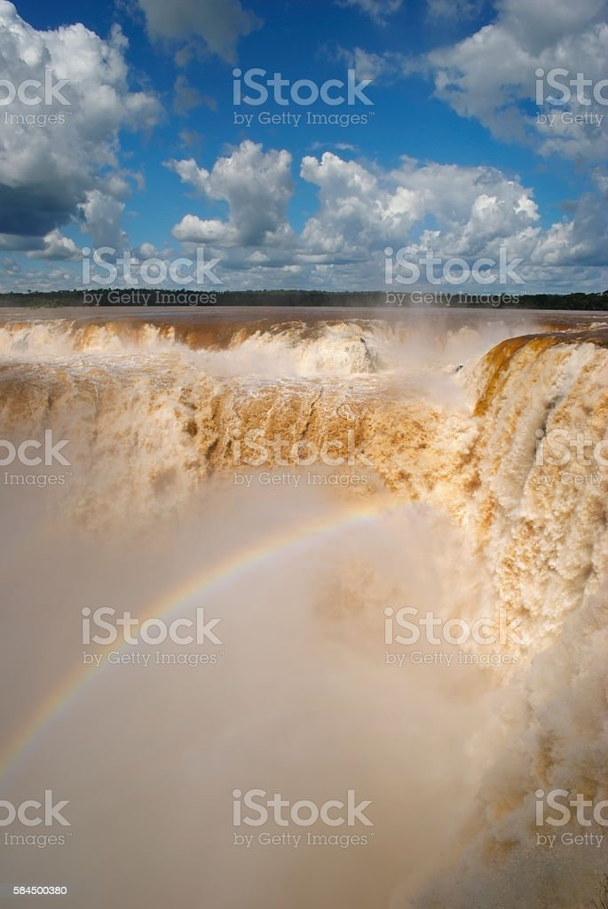 Enormous amounts of water thundering down the Iguazu waterfall stock photo