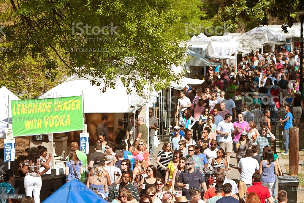 Enormous Crowd Moves Through Exhibit Tents At Atlanta Dogwood Festival stock photo