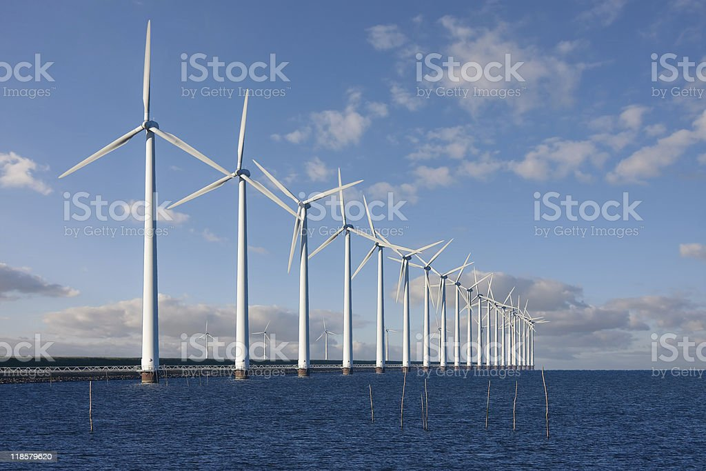 Enormous windmills standing in the sea stock photo