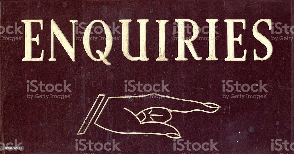 Enquiries Sign pointing finger stock photo